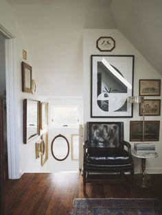 Chairs seem to make a great addition to small nooks. Makes the space functional and a great complement to the hanging art.