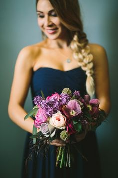 Jewel tones: Navy bridesmaid dress compliments purple and peach roses, lilacs, scabiosa pods and hints of green foliage / Lets Frolic Together Photography