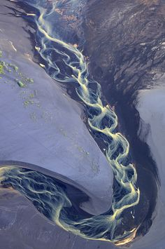 A small river in the south of Iceland that reaches the Atlantic ocean by Andrey Ermolaev, no further info.