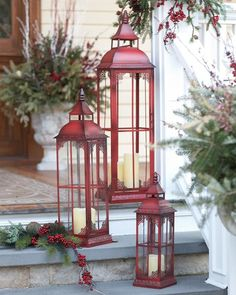 Impressive and beautiful, these pillar candle lanterns add an elegant touch to your holiday décor. Features a rustic red finish, glass windows, decorative cut-outs in the top of venting, and hinged do