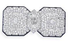 An art deco onyx and diamond brooch, by Cartier, circa 1920