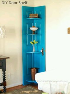 In the girls room.  Didn't use an old door, just bought a cheap one from home depot and cut it in half and reattached and painted it.  I still want to stick on an antique door handle.  It falls over unless you anchor it to the wall.  it should have a little foot in the front middle.