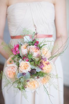 the bride will carry a small bouquet of ivory garden roses, blue