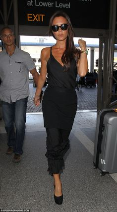 Victoria Beckham - At Los Angeles International Airport.  (August 2014)