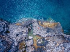 <i>Lady in Red</i>. I shot this picture with my drone during a summer vacation. My wife and I spent several days in Montenegro on the Adriatic Coast, and this shot is from the cove Veslo, located at the eastern part of Luštica peninsula. This is a perfect spot where you get the feelings of coziness, privacy, and relaxation, and this is what I wanted to be reflected in my work. Unspoiled and rugged at the same time, but also a beautiful and authentic landscape is what I found here, and I…