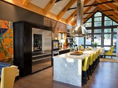 The contemporary kitchen anchors the home's open floor plan. Warm browns, cool tans and brilliant yellows inspired by fall foliage balance the industrial feel of restaurant-style appliances.   http://www.hgtv.com/dream-home/kitchen-pictures-from-hgtv-dream-home-2014/pictures/index.html?soc=pindhm