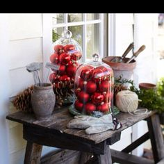 Holiday decor- love the use of cloches outdoors on a porch.