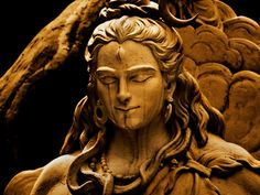 Lord Shiva; peaceful, even with those dark lines coming down his face.