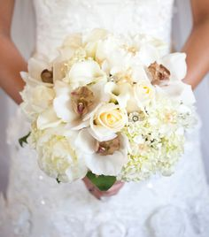 Deena had Pat Phillips at The Flower Merchant, Ltd lace family heirlooms and flowers from her grandmother's wedding veil throughout her bouq...