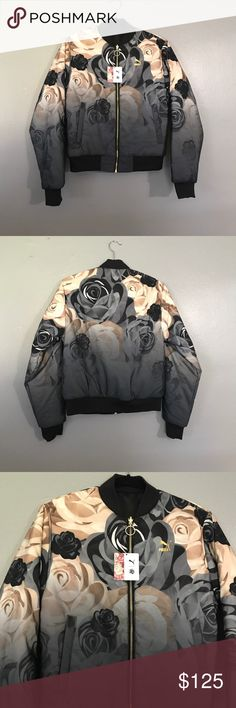 Puma x Careaux Reversible Bomber Reversible Puma x Careaux Bomber jacket. Beautiful rose print on one side. Solid black on the other side. Gold zipper down the front. Pocket functions on both sides. Puma Jackets & Coats