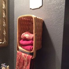 Hang a basket on the wall for hand towel storage and use the handle as a towel bar! Cute!
