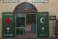 "Pharmacies in Muslim countries feature a crescent rather than a ""red/green cross"" as is common in Christian countries. This one features both.  See where this picture was taken. [?]   http://parapharmacie-en-ligne.eklablog.com/viveo-vous-fait-decouvrir-l-aromatherapie-avec-ses-41-differentes-huil-a96991065"