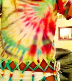 Tie dye shirt fringed and beaded. Idea for Izzi's next tie dye frenzy.