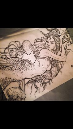 Mermaid tattoo                                                                                                                                                     More