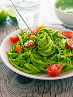 Creamy Avocado-Spinach Pesto Zoodles | 1 avocado, halved and pitted 3 cups baby spinach 2 tablespoons almonds 2 garlic cloves Juice of 1 lime ½ teaspoon fine grain sea salt Red pepper flakes (optional) 1 cup cherry tomatoes, halved 2 tablespoons olive oil