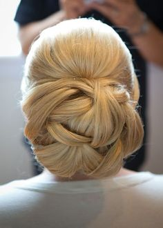 Beautiful woven knot hairstyle! Wedding hair inspiration.