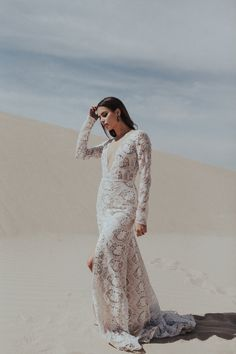 Sarah Seven. wedding dress. wedding gown. long sleeve wedding dress.  deep v wedding dress. wedding dress with slit.
