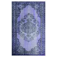 Add a pop of pattern to your living room or den with this artfully crafted rug, showcasing a distressed Persian-inspired motif in purple.