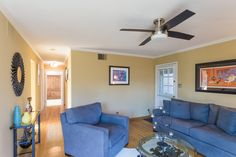 A roomy living room is ready to be the hub of activity, open to the hallway with outside access on two sides.