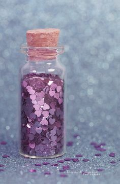 Purple glitter hearts to toss at bride and groom! Cute idea