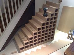 Made to measure wine rack fitted under the stairs