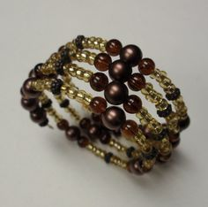 Gold brown bead memory wire bracelet with matching gold earrings