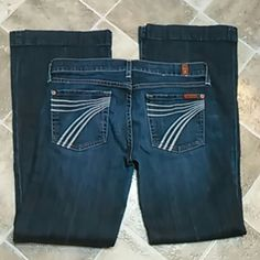 7 for all mankind jeans In EXCELLENT CONDITION!!! No tears or holes or fading. Very minor fraying at the hem.  30' inseam Style: dojo 7 for all Mankind Jeans