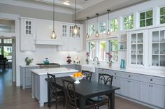 Traditional eat-in kitchen with gray cabinets, white backsplash and an island. More via http://forcreativejuice.com/elegant-white-kitchen-interior-designs/