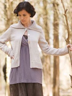 Assemblage is a stockinette cardigan with a wide collar and cuffs in an embossed honey comb pattern stitch.