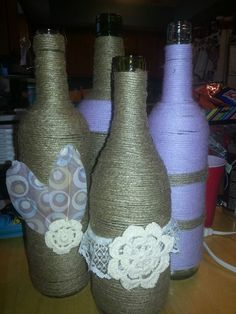 Twine and yarn wrapped wine bottles