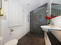Modern bathroom design with louvre windows using frameless glass