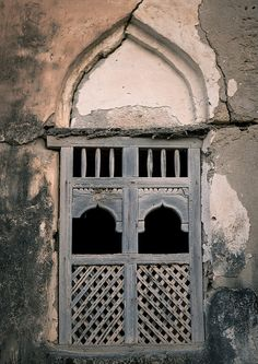 Old arabic wooden window in Salalah, Oman by Eric Lafforgue, via Flickr