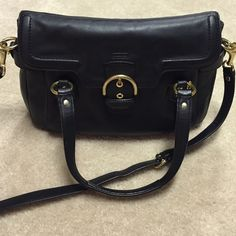 Coach Handbag Coach Black handbag with gold hardwear... Can be used as a shoulder bag, handbag or cross body due to removable/adjustable straps and handles. Has zippered interior side pocket and two additional open side slots. Coach Bags