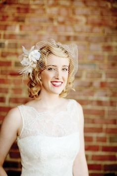 Wedding hair styles: vintage-inspired curls Wysteria birdcage veil with tulle from Ella Weiss