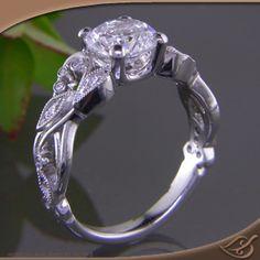 Vintage Style Leaf & Vine Favorite!  Antique Style Engagement ring with a open leaf and vine pattern with (14) bead and bezel set diamonds, a secret celtic trinity knot & milgrain edges.