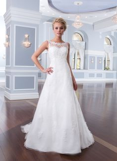 Lillian West lillian west style 6300 This tulle and beaded lace A-line gown has an illusion Sabrina neckline and chapel length train. Satin buttons enclose the illusion back neckline and zipper. Available at Bridal Gallery  5975 Malden Rd. LaSalle,Ontario  519-800-0315