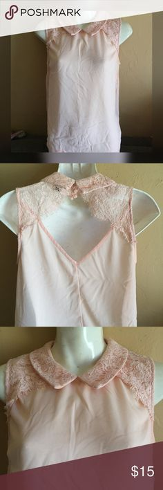 Pink blouse with lace detail Size small . No stretch . Material is somewhat sheer . Tops Blouses