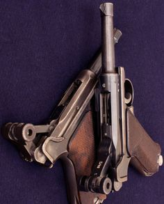 """Two P.08 Parabellum (""""Luger"""") pistols: The upper is a Mauser-made """"G-Date"""" (1935) military model, and the lower is probably a DWM 1920 commercial model."""