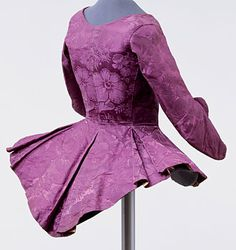 Woman's jacket of purple silk damask, Germany, c. 1750-1770 The large protruding basques once lay decoratively on a hooped petticoat.