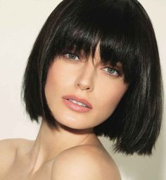 Brunette bob with bangs.