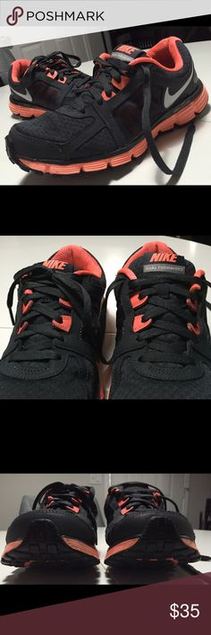 EUC Nike Dual Fusion 2. Black/gray and neon Excellent condition Nike Dual Fusion 2 shoes. Black/gray & neon coral/orange. I got them 1/2 size too big for myself so they don't fit Nike Shoes Athletic Shoes