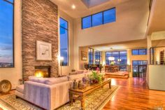 LIVING ROOM: Modern, open space with floor to ceiling stone fireplace. Incredible. #home #design #contemporary
