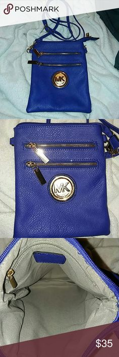 Knock off MK NWOT CROSSBODY BAG Gourgouse purse Regardless but it's not Authentic knock off Michael Kors Beautiful Blue CROSS BODY bag with adjustable strap can be short or go to hop zip closer 2 zip pockets in front and 1 zip pocket in back and 1 zip pocket inside on side Bags Crossbody Bags