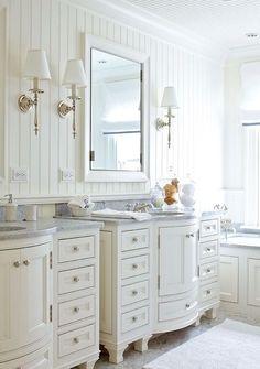 Cabinets in the master bathroom were custom-designed by designer Tom Stringer. - Traditional Home ® / Photo: Werner Straube / Design: Tom Stringer