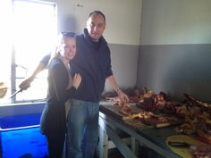 Some of the cattle on the farm were too wild to load for the market. The meat of the one being cut up here to make beef sausage of for braaing and drying to make droee wors (wind-dried sausage). Brigitte and Niel at work here.