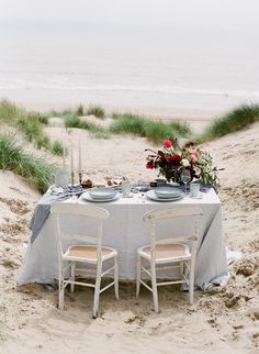Wedding Tablescape With Grey and Blue Silks and Linens - Coastal Wedding Inspiration With Flowers by Blue Sky Flowers Styling by Rosy Apple Events Dresses by Cherry Williams London and Julie Michaelsen Photography