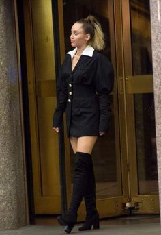 7086cece2bbb Miley Cyrus in a Puff Sleeve Mini Dress by Jacquemus and black over-the-