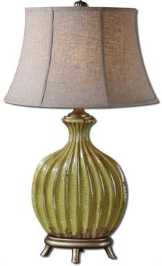 Uttermost Carentino  Heavily crackled, aged green ceramic with rust distressing and antiqued silver details. The oval bell shade is an oatmeal linen fabric with natural slubbing.