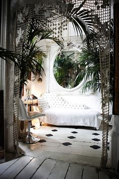 Painted floors, and macrame trelliage at doorway, mirror, palm, whole deal.