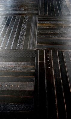 Unique tile flooring for the man cave- made from re-cycled men's belts!